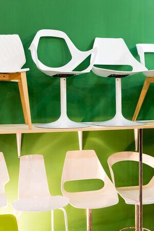 barstool: Bar chairs at a modern green backround, closeup Stock Photo