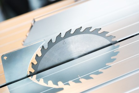 blade cut: Circular saw blade silver color, closeup