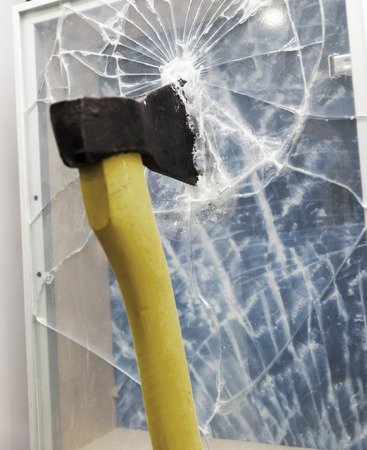 Axe to smash the window glass photo