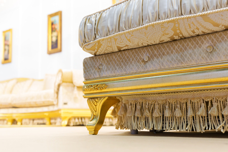 Luxury beige interior with nice big sofa closeup photo
