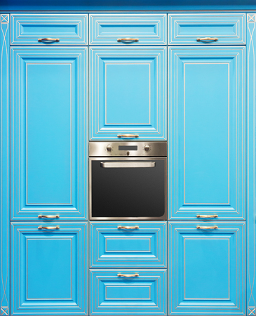 Closeup picture of oven in kitchen blue interior design photo