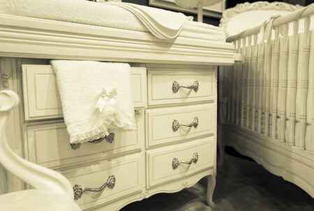 chest of drawers: Vintage mansion white chest of drawers with a towel Stock Photo