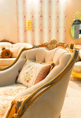 Luxury beige interior with nice chair closeup photo