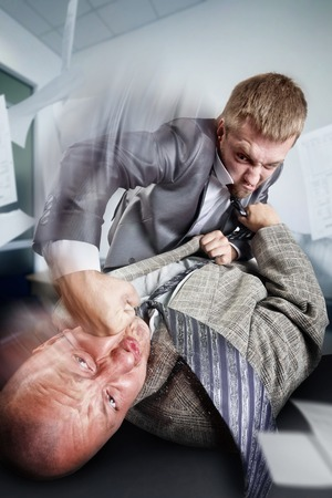 Two furious businessmen are fighting on the table Stock Photo