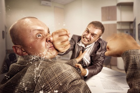 struggle: Two furious businessmen are fighting in the office