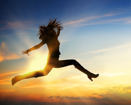 Happy woman jumping at blue cloudy sky Stock Photo - 29986840