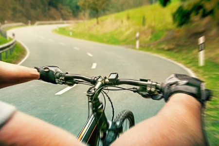 bicycle race: Man riding on a bicycle on highway