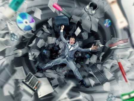 Scared businessman is falling into office chaos photo