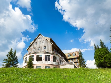 barrack: Big abandoned house in green forest Stock Photo