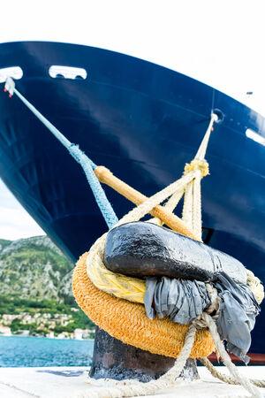 bollard: Cruise ship in harbor locked to bollard.
