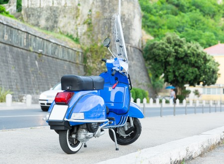 Blue motorbike standing on the street of Montenegro photo