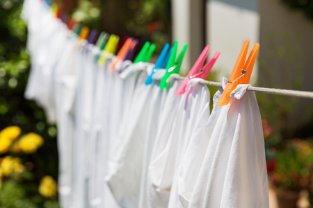 clothes pegs: Cloth with colorful pins at the yard