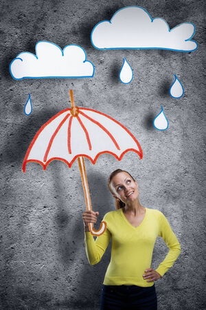 woman umbrella: Smiling young woman with cartoon umbrella