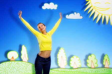 portrait young girl studio: Smiling young pretty woman on sunny cartoon background Stock Photo