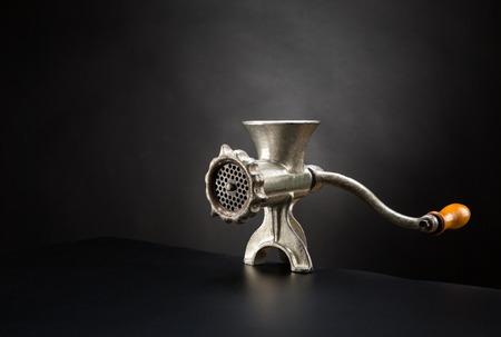 Retro mincing machine on a black background photo