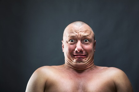 discomfiture: Portrait of bald man with scared face Stock Photo