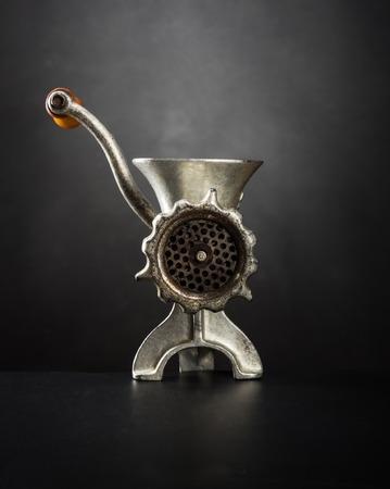 Meat grinder on a black background 스톡 콘텐츠