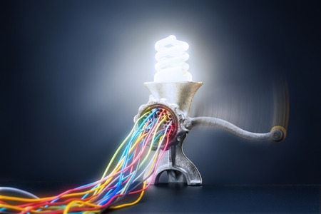 Mincing machine is grinding up a lamp to cables with light photo