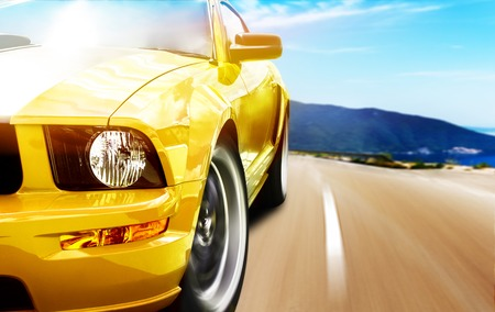 moving activity: Yellow sport car on a narrow road Stock Photo