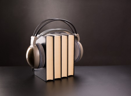 Black books and headphones on it photo