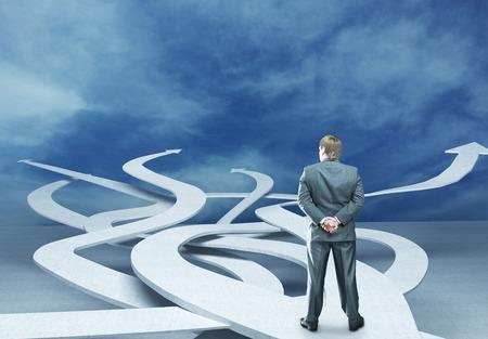 Pensive businessman is choosing right way in sky