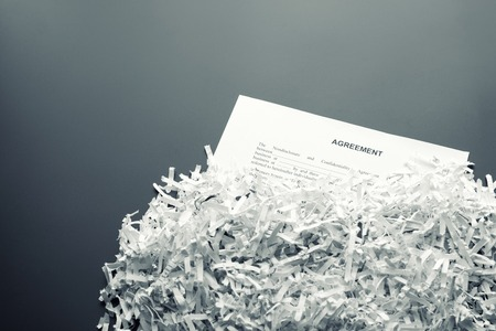 Big heap of white shredded papers with agreement