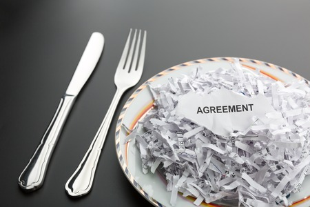 paper shredder: Big heap of white shredded papers on the plate Stock Photo