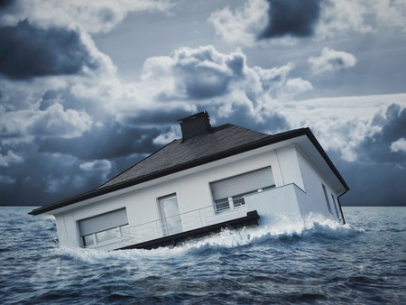 White house is sinking in floodwaters Stock Photo