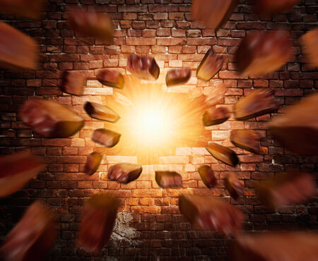 broken brick: Old brick wall with lights and flying bricks from the center