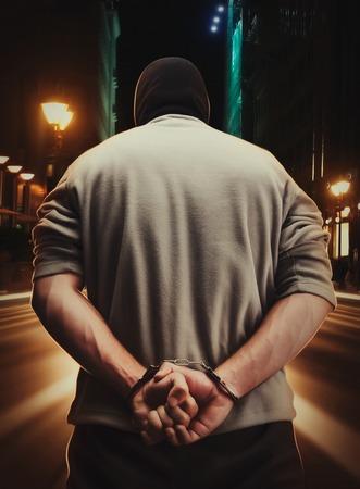 preso: El hombre detenido con esposas, como consecuencia de su crimen Foto de archivo
