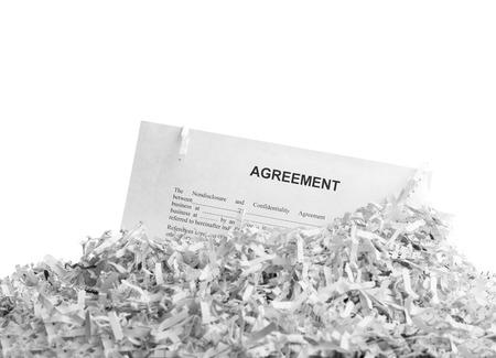 paper shredder: Shredded agreement isolated on white