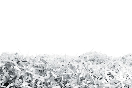 Big heap of white shredded papers isolated on white