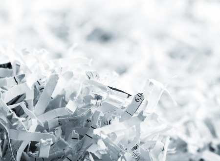 Closeup picture of big heap of white shredded papers