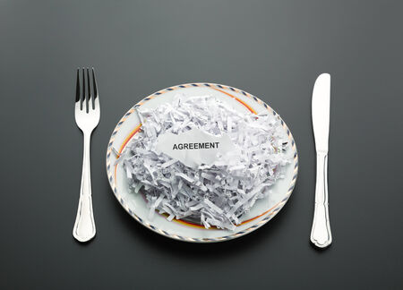 Table set with shredded agreement on the plate photo