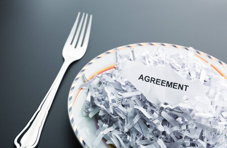 paper shredder: Big heap of shredded paper of agreement on the plate Stock Photo
