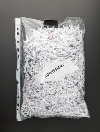 paper shredder: Shredded papers of agreement inside the file