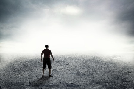 suspense: Human on the road in dense thick fog Stock Photo