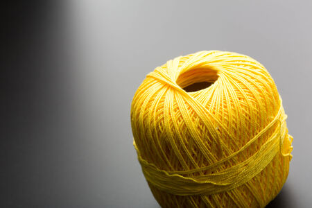 Yellow tangle of thread for knitting photo