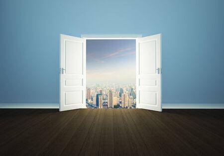 Cityscape behind the open door photo