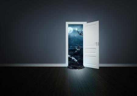 Horror cemetery behind the open door photo