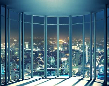 Night view of buildings from the last floor of high rise window, beautiful expensive real estate