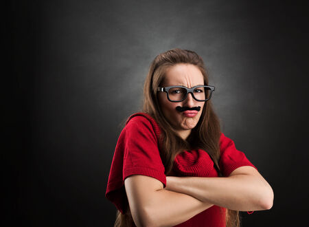 joking: Offended girl wearing glasses and fake mustaches Stock Photo