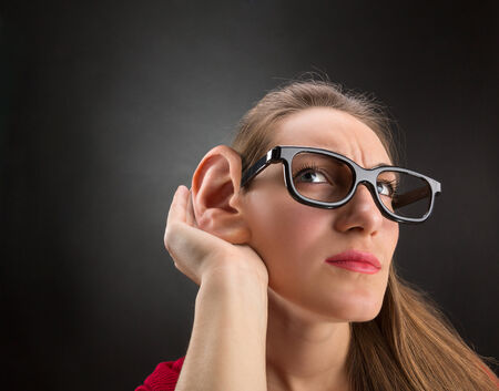 big ear: Woman is listening to with big ear Stock Photo