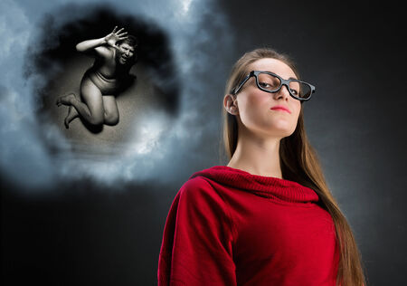 Pensive woman and cloud with her thoughts. Humiliation of man photo