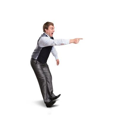Afraid man on white points to something. Isolated on white photo