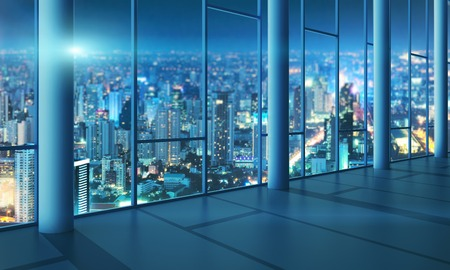 Light hall with glass wall with cityscape at night