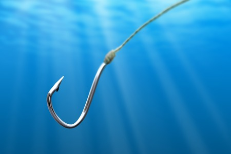 fishing tackle: Fishing hook in the light sea