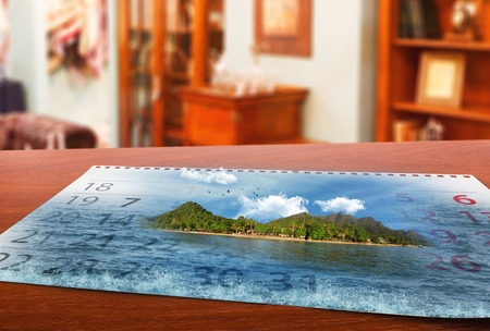 Calendar  with beautiful  landscape  lays on the table