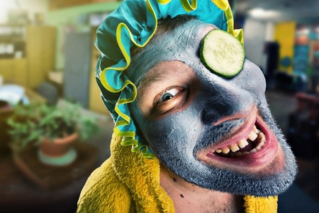 odd: Insane man with face pack in home cosy interior
