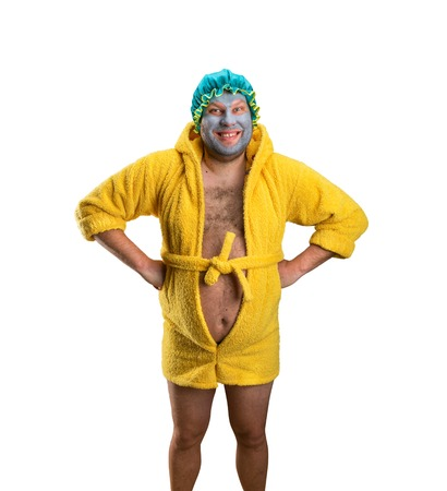 paunch: Crazy man with face pack in bathrobe isolated on white